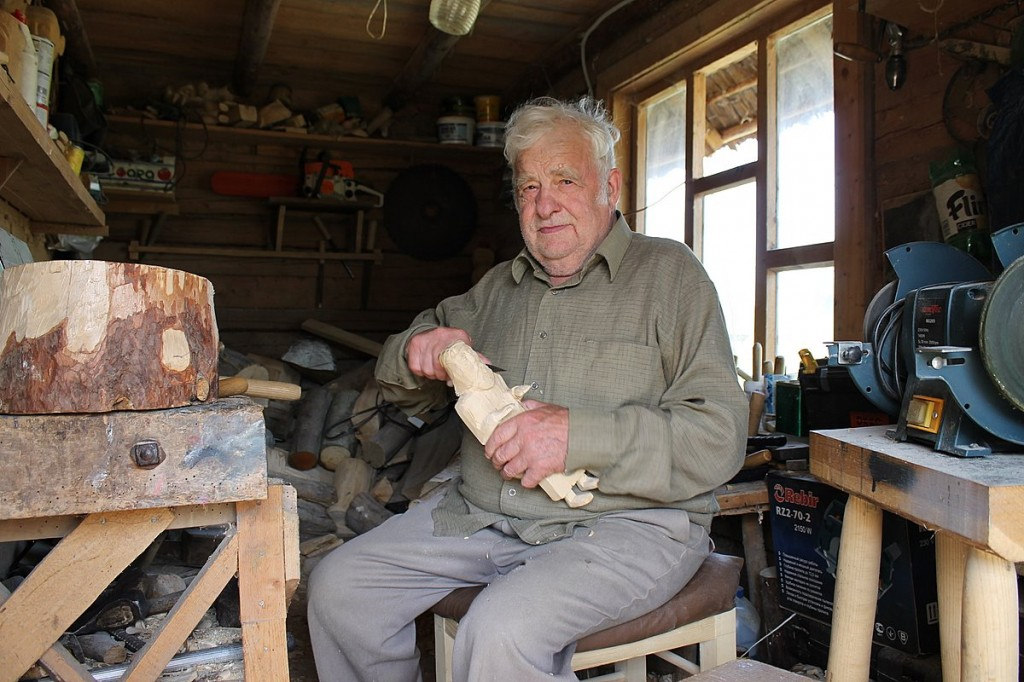 wood carving artist Kasys Striupa in his workshop in Lithuania